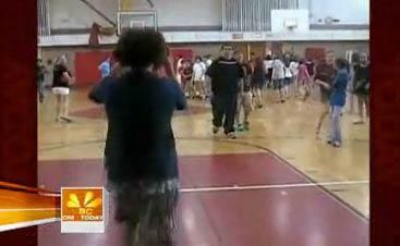 Teen Flips and Shoots Basketball 60 Feet Away