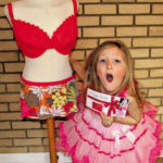 PHOTO: 7 yr-old Poppy Burge with plastic surgery voucher