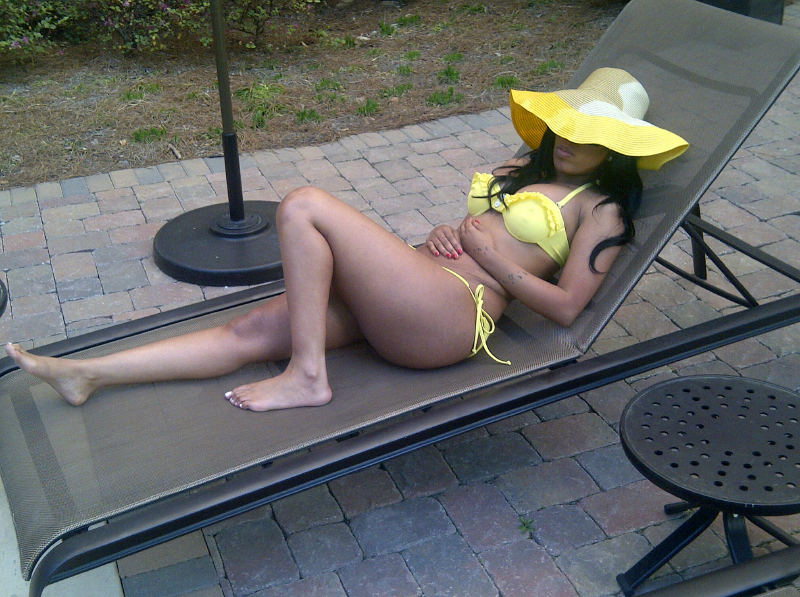 Photo of K. Michelle of Love & Hip Hop Atlanta relaxing in bikini by pool