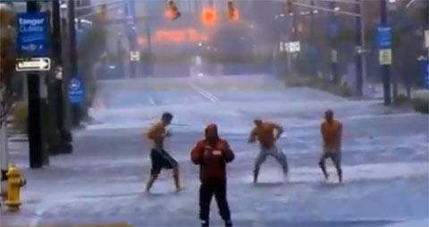 Men Dance Behind Reporter Covering Hurricane Sandy In Atlantic City 2012