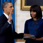 Photo of President Obama taking 2013 Oath of Office with Michelle