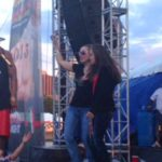 Kidnap victim Amanda Berry on stage with Nelly at Roverfest