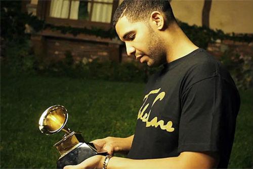 Drake Holding Grammy Award