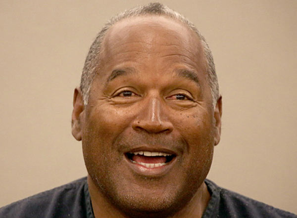 Retired NFL player OJ Simpson gets parole but must stay in jail