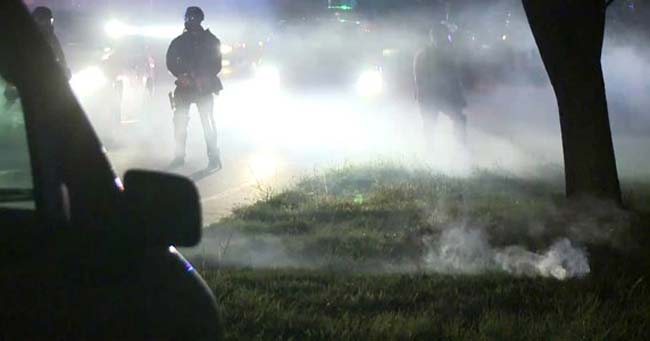 tear gas thrown at protesters Michael Brown