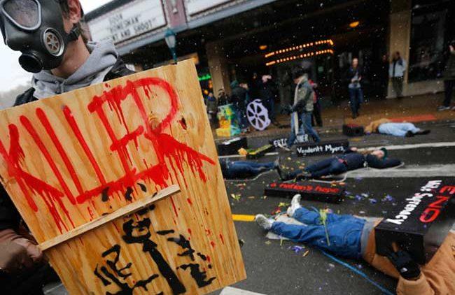 Ferguson protestors lay in street