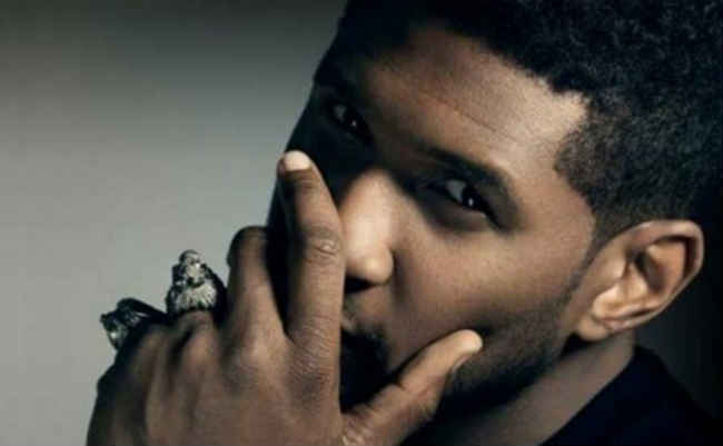 Usher hand over face