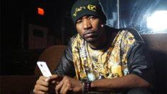 Teflon Don rapper holding iphone
